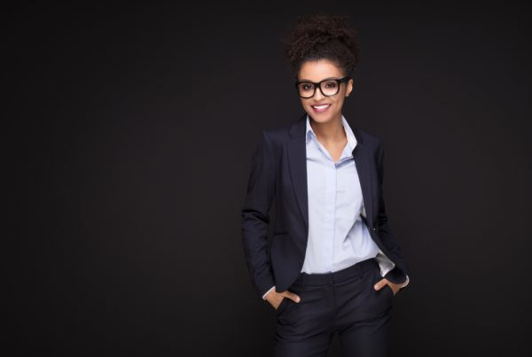 Woman in suit with hands in her pocket