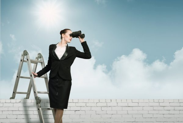 Lady looking for a job on ladder