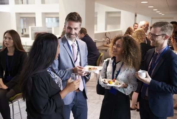 Group of young business people attending a networking event