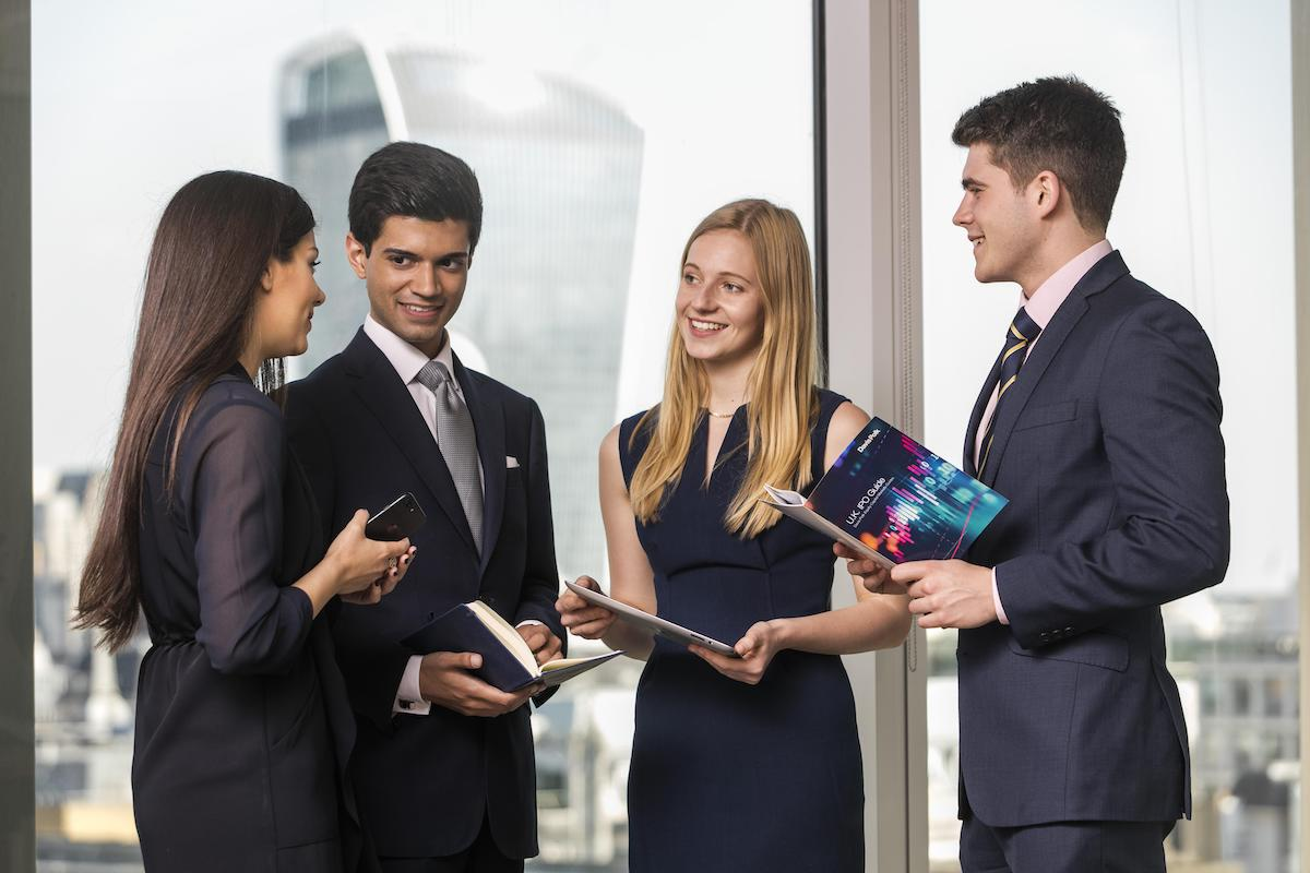 Davis Polk trainees in a conference room having a chat