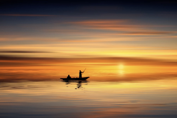 Boat on a lake in the sunset