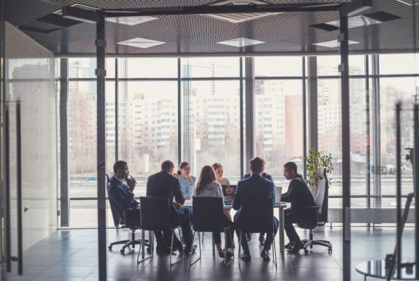 Business people in suits attending a meeting